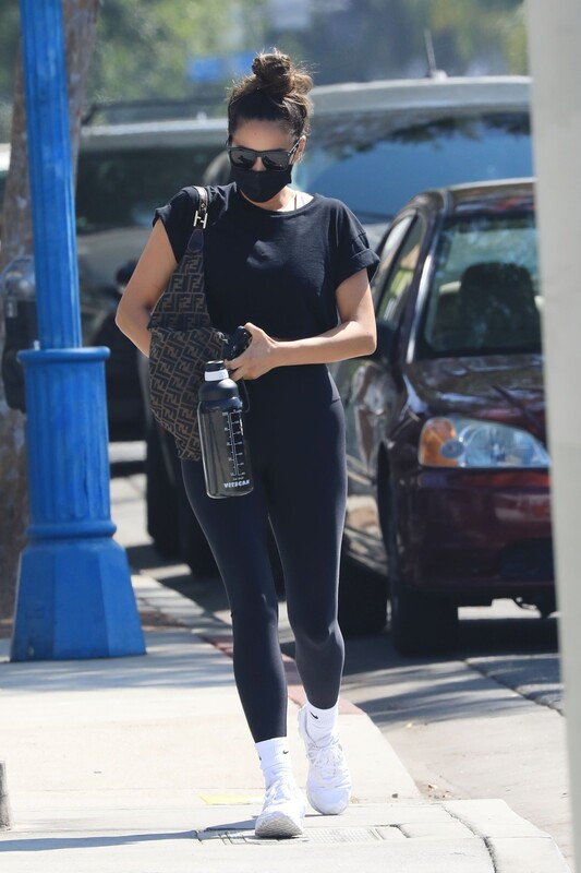 attractive babe Shay Mitchell in black leggings