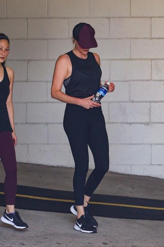sporty milf Charlize Theron in black yogapants