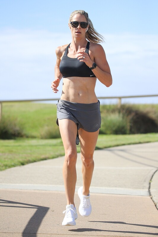 lovely jogger female Candice Warner in sexy gym shorts