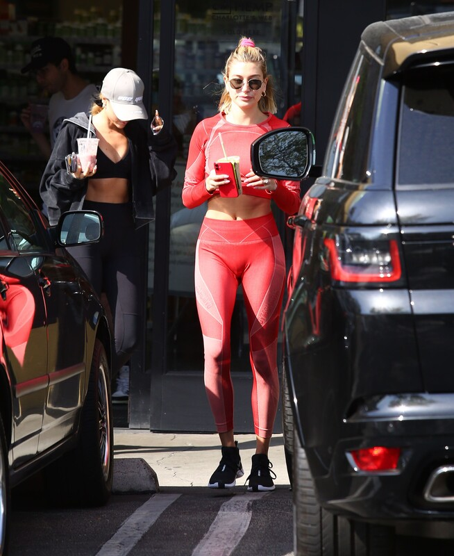 incredible chick Hailey Bieber in red workout outfit