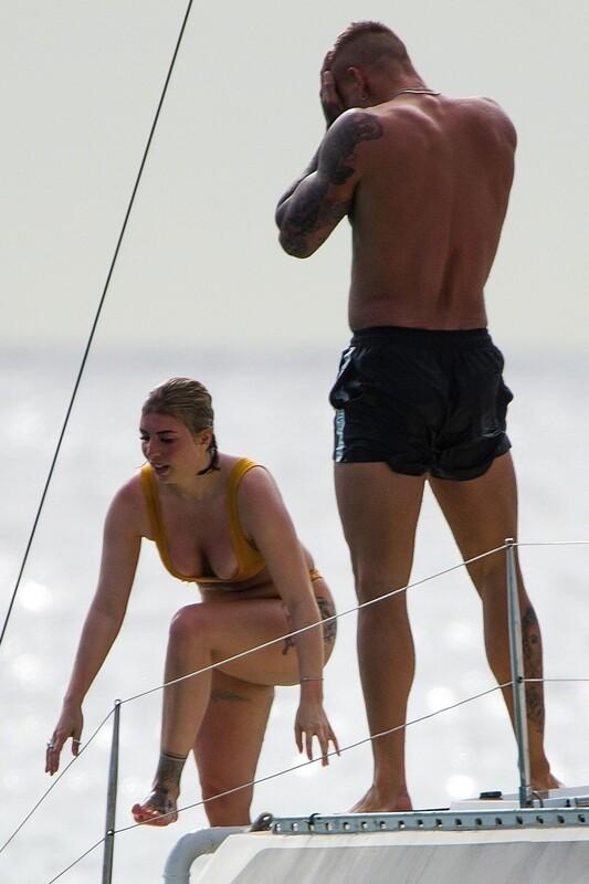 tattoed chick Olivia Buckland in wet yellow bikini