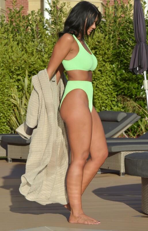 pretty milf Abbie Holborn in green bikini