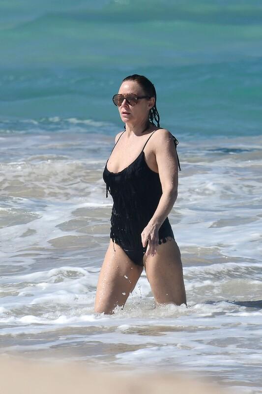 hot milf Stella McCartney in black 1 piece swimsuit