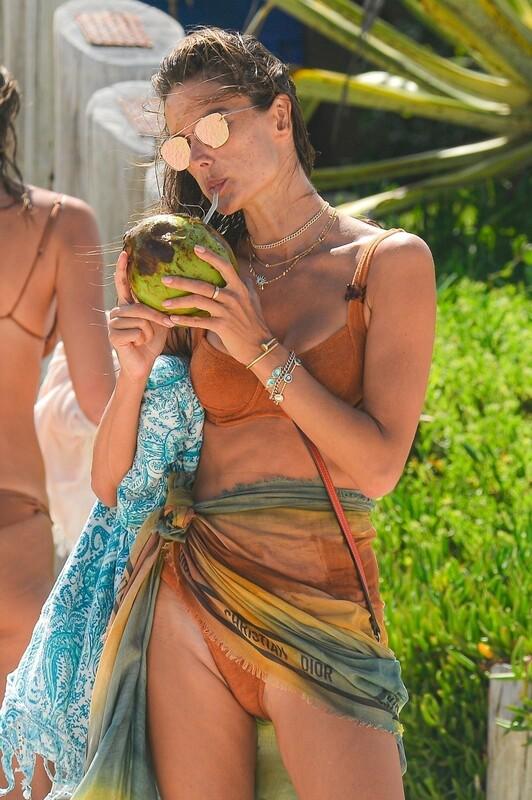 cute beach milf Alessandra Ambrosio in wet orange bikini