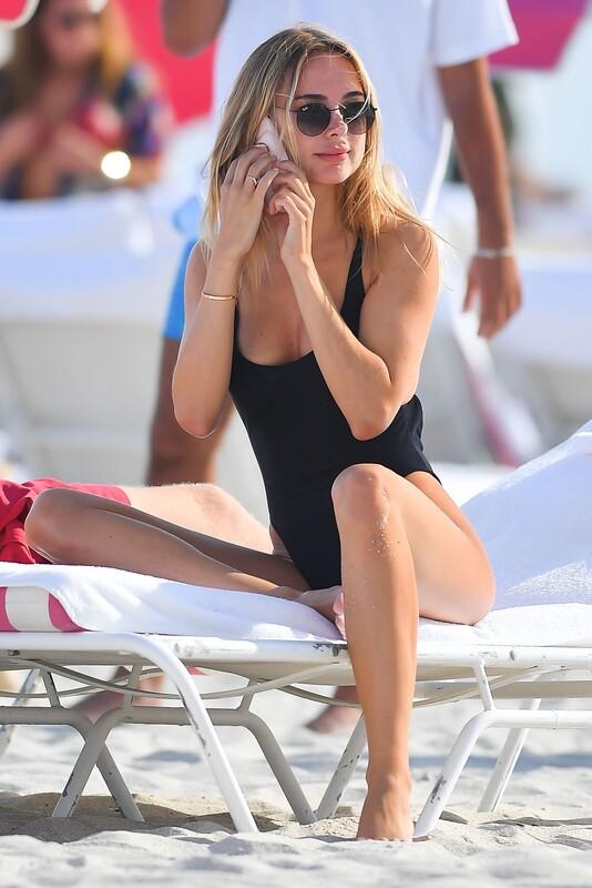 lustful babe Kimberley Garner in black 1 piece bathing suit