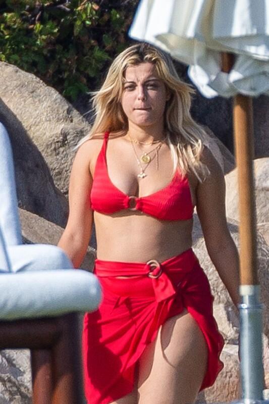handsome chick Bebe Rexha in red bikini