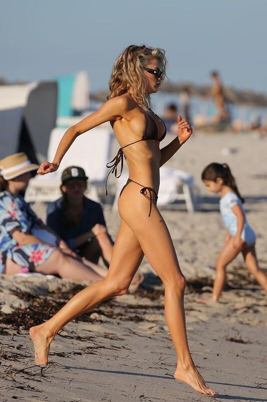 seductive babe Charlotte Mckinney in tiny bikini