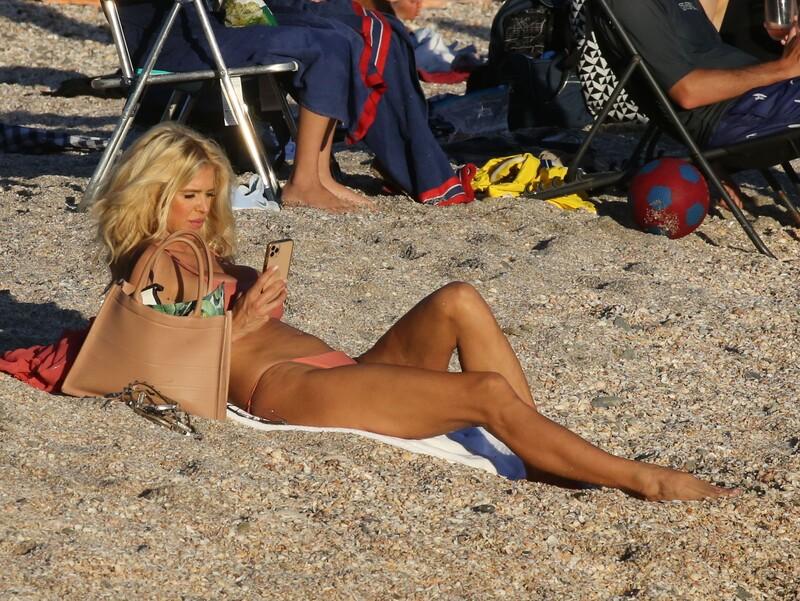 sexy blonde hottie Victoria Silvstedt in peach bikini