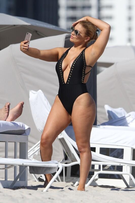 busty milf Andrea Gaviria in black 1 piece swimsuit