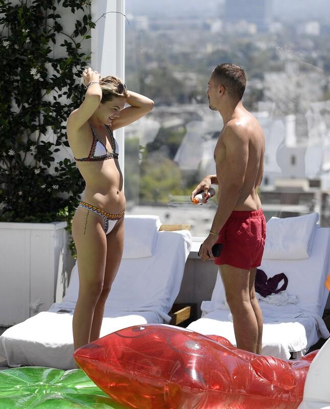 attractive babe Louisa Johnson in sexy wet bikini