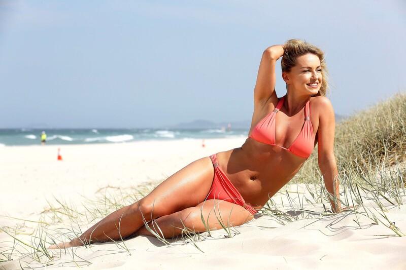cheerful babe Ola Jordan in red bikini