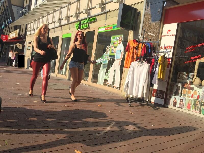 blonde female in red shiny leggings