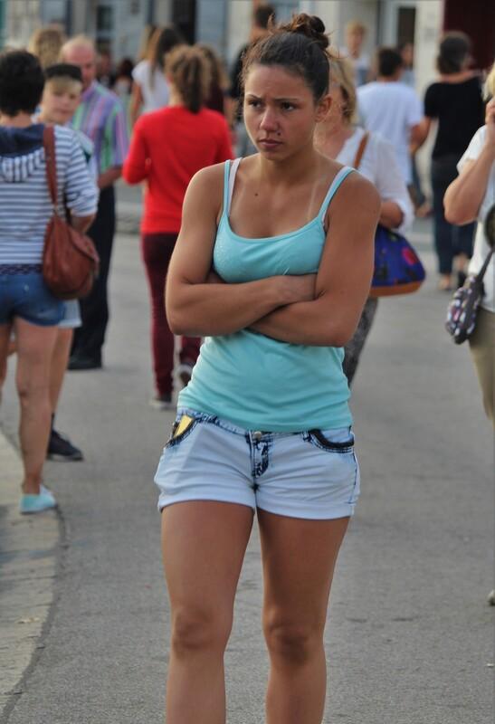 cute college teen in tight denim shorts