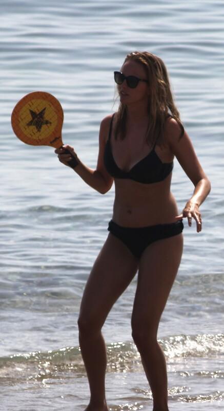 beach tennis girl in lovely bikini