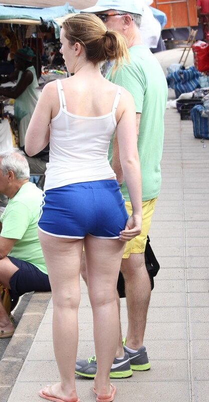 meaty butt in tight blue shorts