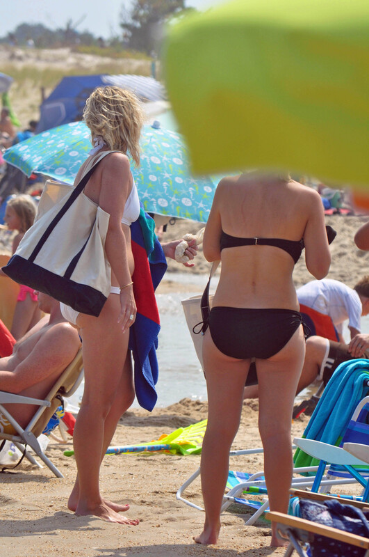 2 hot girls at crowded beach
